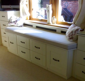 Bedroom upholstered window seat and storage, in Ivory